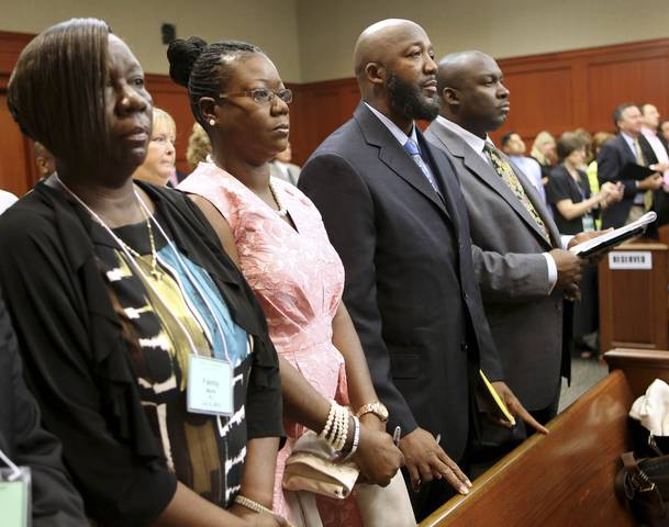 The parents of Trayvon Martin stand for the jury at the start of the George Zimmerman trial in Seminole circuit court in Sanford