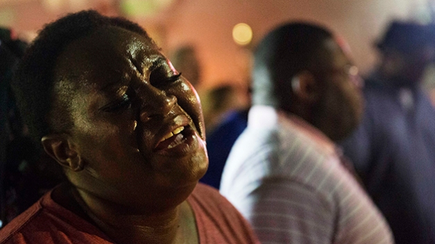 Lisa Doctor joins a prayer circle down the street from the Emanuel AME Church early Thursday, June 18, 2015 following a shooting Wednesday night in Charleston, S.C. (AP Photo/David Goldman)